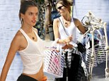 Tiny tummy: Alessandra Ambrosio exposed her bare belly in a knotted tank-top on Thursday while working out at a Los Angeles gym and later got into the Halloween spirit