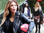 Skinny Kim leads Kardashian clan as they take over ENTIRE amusement park... but where's baby North?