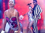 It won't stop! Pint-sized Kelly Ripa twerks on towering co-host Michael Strahan as duo are the latest to dress up as Miley Cyrus and Robin Thicke for Halloween