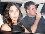 Habit: Simon Cowell lights up as he leaves St Martin's Theatre, London, with New York socialite Lauren Silverman, who is reportedly carrying his child. His habit was criticised by a charity which argued smoking harms the unborn child