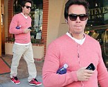Metrosexual Mark! Wahlberg shows off his feminine side in pink jumper and matching trainers as he runs errands solo