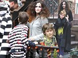 What a fright! Liv Tyler greets trick or treaters with candy before donning witch costume to go door to door with son Milo