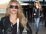 Same, same not so different! Shakira wears her favourite combination of denim and leather as she once again jets out of Los Angeles