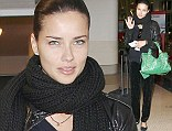 Adriana Lima looks stunning despite make-up free appearance in leather jacket and velvet trousers