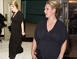 Pregnant Zara Phillips hides growing tum in floor-length black gown as she enjoys night out at British Olympic Ball