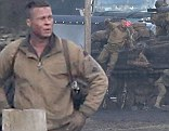 Brad Pitt gets down and dirty as he shoots tank scenes on set of new World War Two movie