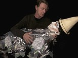 Resurrection: David Bowie uses puppet replica of his harlequin costume from Ashes To Ashes, for new video, Love Is Lost