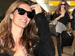 She doesn't need anymore slimming! Super slender Gisele Bundchen dresses in head-to-toe black as she arrives home in Brazil for Sao Paulo Fashion Week
