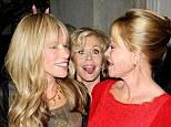 Comedic antics: Jane Fonda photobombed Carly Simon and Melanie Griffith at the Oceana's Partners Awards Gala in Los Angeles, on Wednesday night