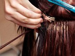 Gruesome: A Kenyan legal assistant suffered terrible headaches after unwittingly wearing a human hair weave like this one that was reportedly filled with flesh-eating maggots that burrowed into her head (file picture)