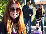 Look who's in the driver's seat! Alyson Hannigan pushes daughter Keeva in a toy car during stroll with husband Alexis Denisof