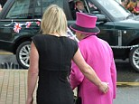 Faux pas: Shop manager Kerry Bickerstaff appeared to touch the Queen as she escorted her inside West Quay Fisheries in Newhaven, East Sussex