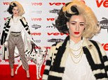 Iggy Azalea has makes a very convincing Cruella Deville as she dresses up as the 101 Dalmatians villian for the red carpet at the Vevo Halloween party.
