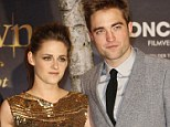 On again, off again: Kristen Stewart and Robert Pattinson in November last year