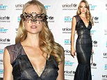 Model Lindsay Ellingson outshines the competition in shimmering mermaid-inspired gown and gold Venetian mask at UNICEF Masquerade Ball