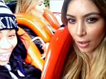 Scream if you want to go faster! Kim Kardashian gets her thrills on a death-defying rollercoaster as she celebrates Kendall's birthday at amusement park