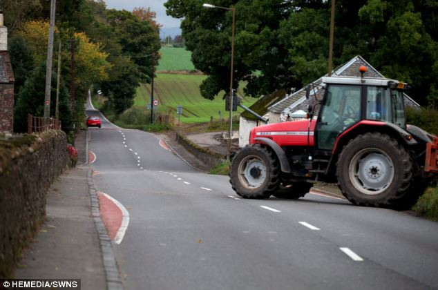 Long and winding road: A tractor navigates the bizarre traffic calming measures