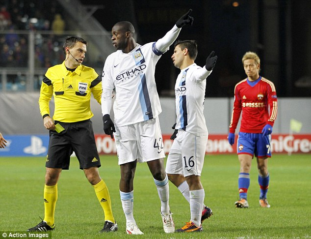 Making his feelings clear: Yaya Toure tells referee Ovidiu Hategan about the abuse from CSKA Moscow fans
