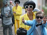 Gangnam style: Julie Bowen dressed as the yellow-clad sidekick of her son's character Psy as they went Halloween trick-or-treating on Thursday in Los Angeles
