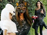 What's new pussycat? Alessandra Ambrosio dons kitty mask as she goes out for Halloween with her family