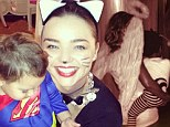 Angelic Beyonce cradles her little caterpillar Blue Ivy... as feline Miranda Kerr giggles with Superman Flynn on Halloween