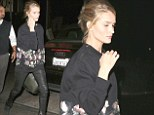 Coming up Rosie's! Ms Huntington-Whiteley does oversized chic in floral jumper and skintight leather trousers