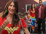 Well at least someone is in the spirit! Adam Sandler's wife is unmissable in her Halloween costume while the funnyman and his daughter skip on festive attire
