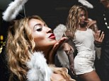 We can see your Halo! Beyonce is a flirty angel in micro white shorts and feathery wings for Halloween bash in Australia
