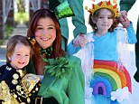 Keeping up the tradition: Alyson Hannigan continues her trend for fun family Halloween costumes as a Leprechaun to her daughters' rainbow and pot of gold