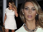 She's a mom now! Kim Kardashian pulls her very short shift dress down to preserve her modesty as she leaves TV studio