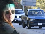 Are they back on again? Kristen Stewart and Robert Pattinson pictured leaving his Beverly Hills home after pair enjoy a four hour rendezvous together
