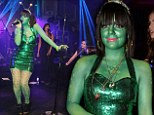It's Lily Alien! Singer covers herself in green paint for an extra-terrestrial look as she unveils newly-slim figure for Halloween performance
