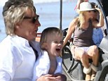 Rod Stewart cradles son Aiden before giving wife Penny Lancaster affectionate pat on thigh on beachside set of his new commercial
