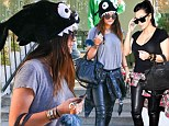 Just like Kim! Kylie Jenner, 16, adopts her sister's style once again as she pairs skintight leather trousers with a shark novelty hat on Halloween