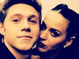 'She said yes!' Niall Horan tweeted Katy Perry's response to his joke proposal along with this shot, in which she drapes herself across his shoulder