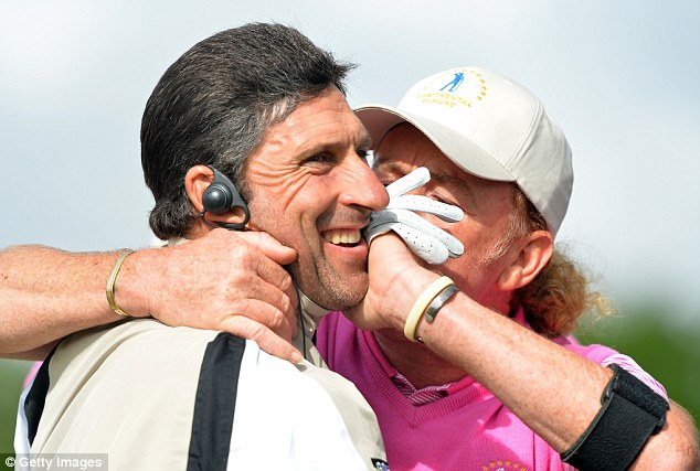 Smacker: Miguel Angel Jimenez kisses his captain Jose Maria Olazabal
