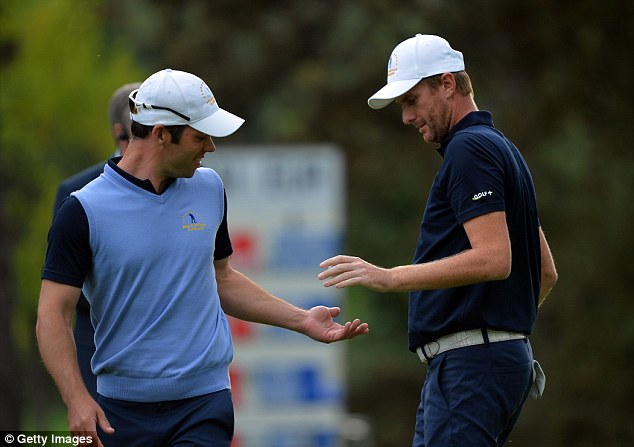 Put it there: Paul Casey (left) celebrates with David Lynn as the pair claimed a point for Great Britain and Ireland