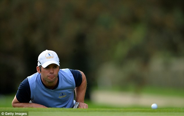 Eyeing it up: Paul Casey lines up a putt at the St Nom La Breteche course near Paris