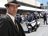'Gun fire. Locked down. Evacuating!' Filming grinds to a halt on the set of Mad Men as the cast and crew get caught up in the terrifying shooting at LAX