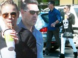 A show of unity: LeAnn Rimes holds hands with husband Eddie Cibiran as they head out for a healthy juice following impending split rumours