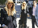 'I'm super pregnant!' says Rachel Zoe as she finally shows off her baby bump at eight months along, 'It's there... I feel it'