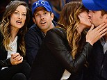Caught kissing while courtside: Pregnant Olivia Wilde and Jason Sudeikis show their love at a Lakers game