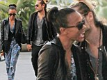Tucking into his Halloween treat! Zoe Saldana's new husband nuzzles her as they take dog for a walk