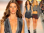 Pins on parade! Gisele Bundchen and Erin Heatherton display their endless legs on the catwalk at Sao Paulo Fashion Week