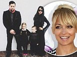 They're creepy and they're kooky! Nicole Richie, Joel Madden and their two children dress as the Addams Family for Halloween