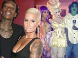 After a week of playing dress-up Amber Rose and Wiz Khalifa ditch the costumes to host The Wiz of TAO Halloween Spectacular in Las Vegas
