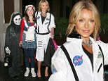 She's out of this world! Kelly Ripa is a very glamorous astronaut complete with high heels as she arrives at Halloween parade with children in tow