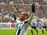 Winner: Yoan Gouffran celebrates the header that gave Newcastle all three points over Chelsea
