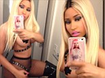 Did you forget your costume? Nicki Minaj shares picture of herself dressed in thigh high boots and nipple pasties for Halloween