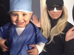 'I'm a REAL Beverly Hills housewife!' Giuliana Rancic sports a fake nose job as son Duke is a Halloween surgeon